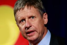 "Gary Johnson: Ryan's no libertarian ""He voted for the Patriot Act, he voted for the National Defense Appropriation Act, he voted to ban online poker, he's proposing a budget that gets balanced in thirty years. He is anything but a libertarian, anything but,"" said Johnson after a packed campaign dinner at Hill's Café."