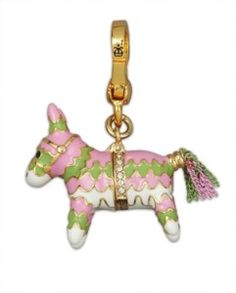 Juicy Couture piñata charm. This opens up and has a piece of candy inside. :)