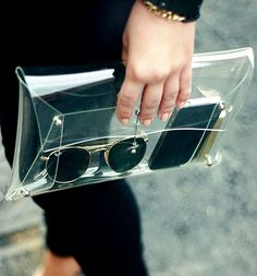 transparent clutch bag --- might prompt you to stop bringing so much unessesary junk everywhere