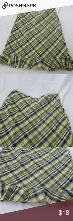 Tommy Hilfiger Plaid Skirt  Size 6 This is a cute skirt from Tommy Hilfiger. It is size 6 and is 100% cotton. The waist measures about 14 inches and the length is about 23 inches. Any questions, please ask! Tommy Hilfiger Skirts