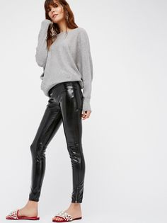 Patent Vegan Leather Leggings | Shiny patent vegan leather leggings. Wear with an oversized sweater or dress up for a night out, this veritable style looks good with just about anything.    * Flat back pocket details