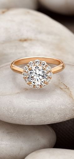 The subtle floral diamond halo blooms around the center gem in this exquisite rose gold ring.