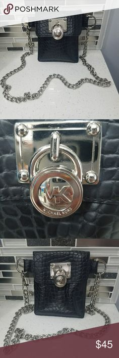 Michael Kors Vintage Black Belt Fanny Pack Used once.   Great accessory and super cute if you don't feel like carrying a purse.   The chain is adjustable and goes up to 40 inches.   The fanny pack is 5 inches wide and 5 1/2 inches long. Michael Kors Bags Mini Bags
