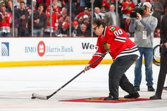 Actor Dan Aykroyd concentrates as he shoots the puck during intermission. #Blackhawks