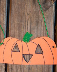 Get ready for #Halloween with this pumpkin mask! Your child will practice drawing and cutting out triangles when he's making his half-face mask. As soon as he dons the finished mask, he can spook his friends, ensuring Halloween-y delight for all. #kidscrafts #preschool (pinned by Super Simple Songs)