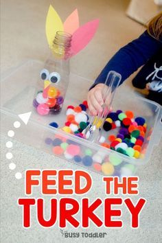 Feed the turkey! A fun fine motor game for toddlers this holiday season! A great way to keep little ones busy during Thanksgiving. #thanksgivnggames #toddlers #finemotorskills