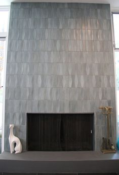 Fireplace idea Heath Ceramics tile in layered glaze in chalk-gunmetal Tiled Fireplace Wall, Victorian Fireplace Tiles, Fireplace Tile Surround, Fireplace Hearth, Home Fireplace, Fireplace Remodel, Fireplace Surrounds, Fireplace Design, Fireplace Ideas