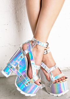 Y.R.U. Holographic Nightcall Platform Heels cuz we''re gettin' strappy, bae! Buckle in with these sikk heels, featurin'' an insane silver holographic construction that reflects tonz of bright iridescent hues, silver hardware, buckled ankle straps, open toe, sky high heels 'N thick platforms, contrasting white treaded soles, and sikk strappy harness details.