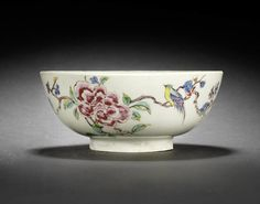 An early Bow bowl, circa 1750-53 Enamelled with 'Wet' colours in famille rose tones, with a large puce peony flower issuing from trailing branches, framed by a colourful bird perched to the right and another in flight, the interior enamelled with 'sacred scrolls China : More At FOSTERGINGER @ Pinterest