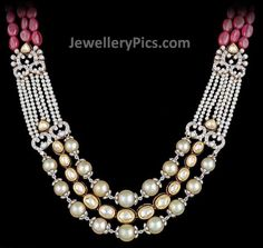 A long necklace with a blend of Pearls, diamonds and uncut diamonds held together by Pink stones - Latest Jewellery Designs