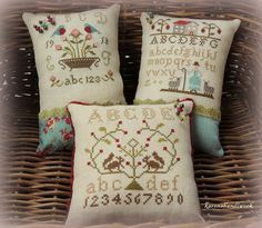 Karen's beautiful pin cushions.  Friendship Samplers by With Thy Needle & Thread.
