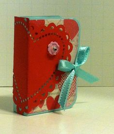 I love this More Amore Tic Tac Holder.  It has everything you want for Valentine's Day: hearts, flowers, candy & bling!!!  This was one of the projects at the February stamp camps. All supplies are from Stampin' Up! (More Amore Designer Series Paper, Bitty Buttons, Pool Party Ribbon.)