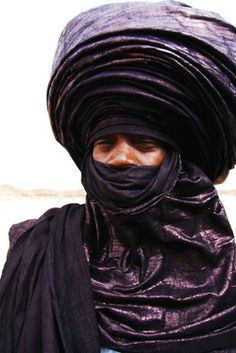 "The Tuareg Tribe. The men wear the veils not the women. Keeps them protected from sun and sand, but also keeps them confined and anti-social. ""Blue Men of the Desert"" because the blue indigo that the fabric is dyed in rubs off on their skin. Turbans can be made with 16.5 feet of fabric."