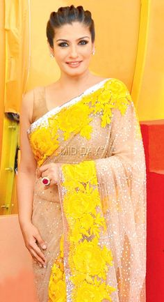 Raveena Tandon togged up in a yellow and beige saree at an event in Mumbai. #Bollywood #Fashion #Style #Beauty #Saree #Desi