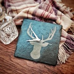 A beautiful hand crafted slate clock engraved with a stag's head.  Perfect for any country, rustic home decor.  Living room decorating | Country Homes and Interiors | www.plattersinteriors.co.uk