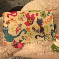 Lily Bloom wristlet for cat lovers new Brand new with tags. Precious print for cat lovers. Lily Bloom! Lily Bloom Bags Clutches & Wristlets