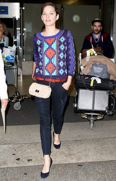 Tres belle: French actress Marion Cotillard arrives make-up free at LAX on Monday