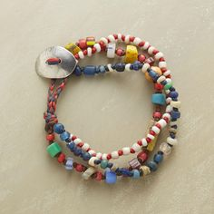 """TRADEWINDS BRACELET--Three knotted strands of antique trade beads are Jes MaHarry's expression of life's boundless roads to travel. Pewter button and loop clasp. Exclusive. Handmade in USA. 7-1/2""""L."""