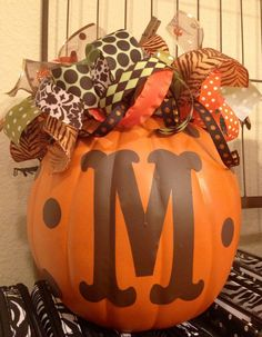 Monogram Pumpkin--love the ribbons on top too.