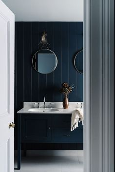 Minimalist Decor Moody dark blue bathroom with vertical panelling and circular mirrors at Lumiere Lodge Hobart Tasmania.Minimalist Decor Moody dark blue bathroom with vertical panelling and circular mirrors at Lumiere Lodge Hobart Tasmania Dark Blue Bathrooms, Navy Bathroom, Small Bathroom, Bathroom Ideas, Bathroom Bath, Bath Tub, Bathroom Interior, Master Bathroom, Victorian Cottage