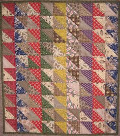 Half square triangles with gray/taupes.....Collection of Gwen Marston