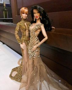 WEBSTA @ irahflowers - My Lovely creations at the Miss FR Universe 2016!Imogen wearing a #zuhairmurad long sleeve mermaid dress in gold and silver and Kesenia wearing a #leoalmodal creation!