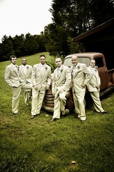 """Yes, I went """"ahh"""" when I saw this photo...LOVE the vintage trucks and the white tuxes instead of black for a wedding is so cool."""