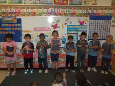 Ordinal Numbers:   ordinal number memory game - students stand in a line holding shape cards and other students play by asking a person to turn their card over using their ordinal position. If they get a match those students just sit down so we are able to still count them in ordinal number order.