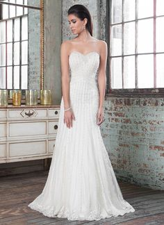Sweetheart beaded neckline A-line gown with beading at waistline that creates a slimming focal point. The lavish beading and vertical lace accents adorning this gown make it red carpet ready. https://www.justinalexanderbridal.com/signature_wedding_dresses/9803