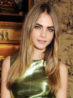 """Ah yes, those brows. Delevingne's world-famous arches, along with a swoop of inky black liner, were in full force at the 2012 British Fashion Awards. """"Cara's brows give her a strong look without having to do anything else,"""" says Rowe."""