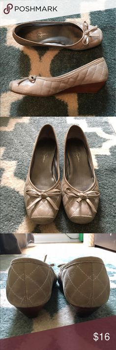 Jessica Simpson Quilted Wedge Heels Jessica Simpson metallic silver quilted low wedge heels with wooden sole. Very comfortable, good condition with discoloration at toe and wear at sole. Jessica Simpson Shoes Wedges