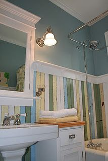Really drawn to this wainscoting made from distressed painted boards in a variety of sea-glass colors (blue, green, yellow, white).  Blue color on the upper wall is awesome.