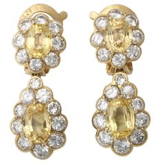 A pair of white diamond and yellow sapphire earrings signed VCA, 1970s