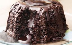 Try Godiva Molten Chocolate Bundt cake! You'll just need 4 oz Godiva dark chocolate Callets, cup boiling water, 1 tbs espresso powder, 1 cup sour cream. Sweet Street Desserts, Volcano Cake, Cake Recipes, Dessert Recipes, Delicious Desserts, Yummy Food, Chocolate Lava Cake, Honey Chocolate, Chocolate Volcano