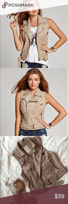 Guess Fashion Faux Suede Vest Tan Beige Small PRE-OWNED fashion vest by GUESS  Channel the rebellious biker-glam look with this faux-suede vest.  - Faux-suede vest. Spread collar. Sleeveless. - Epaulettes. Zippered and flap patch pocket details. Removable belt with buckle closure. Two front zipper pockets. - Off-center zipper closure. Lined. - Shell:  90% Polyester, 10% Spandex. -Lining: 95% Polyester, 5% Spandex. - Dry clean - Style: Fiona - Size: SMALL - Color: Beige/Tan - Condition: LIKE…