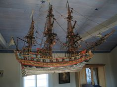 All old and new NORWEGIAN Churches, have a ship hanging from the ceiling.  It's a throwback to the ancient ways.  The Sea, the Fishermen, The Travel, the importance of importing from other lands -- has a holy place.