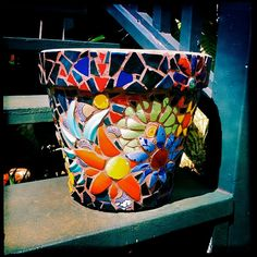 I think this is a beautiful and happy pot!     Colorful Mosaic Flower Pot Custom Orders Only at this by Wingbones, $150.00