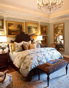 The heavily-framed landscape portraits, chandelier and dark wooden bed frame/headboard give this bedroom a very definite period feel: Designer: Gary Riggs