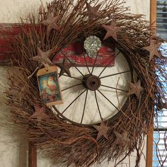 Rusty Wheel Wreath .... Possibly an old bicycle wheel? And use outside for the holidays by adding battery operated or solar lights ( just picked up a string of solar lights for about $10 at Walmart in the garden center)