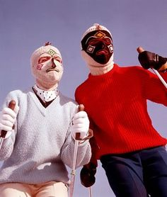 1960: Two skiers, in knitted, patterned balaclavas.