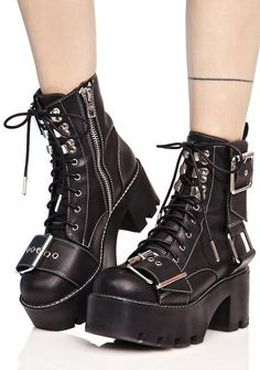 "Dollskill Current Mood Tank Boots £68.03 Current Mood Tank Boots are gunna come roarin' down the streetz, BB~! These ultra cool treaded boots feature a smooth vegan leather construction, thick platform soles, white contrast stitching, supa chunky adjustable buckles across the toe and down the side, lace-ups, and inner ankle zip closures. BLACK Man Made Materials 2.75"" Heels 1.75"" Platforms"