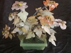Heavy Multi Colour Alabaster Flower Garden in rectangular base alabaster pot Slight damage to a couple of petals Dimensions +/- . 420 x 320 x 160 (mm) : x x (inch) Weight +/- . 1770 g : ounces Floral Wreath, Arts And Crafts, Base, Couple, Wreaths, Colour, Ornaments, Garden, Flowers