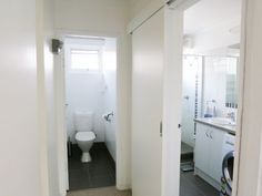 The renovated toilet, bathroom and laundry at the Mount Eliza home unit / apartment for sale.