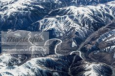 Aerial view of snow capped mountains and road, Western China, East Asia  – Image © Cultura RM / Masterfile.com: Creative Stock Photos, Vectors and Illustrations for Web, Mobile and Print