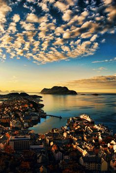 sunset over aalesund harbour norway