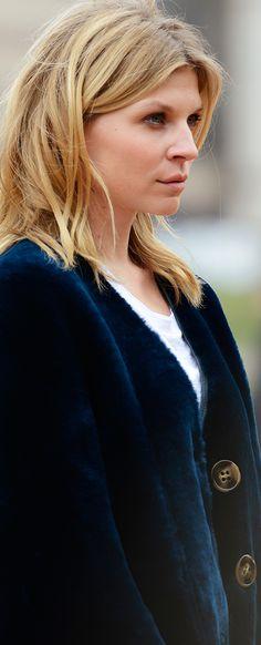 Clémence Poésy wears an A-line cape in dark navy shearling