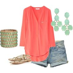 coral blouse and jeans