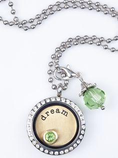 """Medium Silver Locket With Crystals, with Gold Metal Plate and Green Accents.  Makes a perfect """"statement"""" piece for your wardrobe, or as a gift for a special person with Dreams of their own!"""
