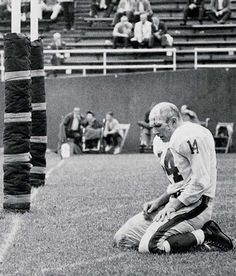 He was never the most talented, but Y.A. Tittle was always the gutsiest. Apparently suffering from broken ribs and a crushed ego during his final season of his Giants career, Tittle is photographed by Morris Berman kneeling down in defeat, bloodied and bruised. Passionate, determined, heroic.