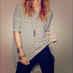 Free People Flowy Striped Tee EUC. Flowy long striped tee from FP's We The Free Line. Size xs/small. Raw hem and edges. 1 small hole on backside from washing but not noticeable on. Free People Tops